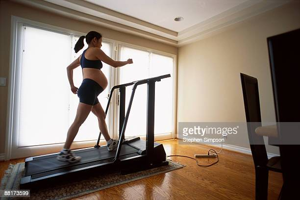 Pregnant woman exercising on treadmill