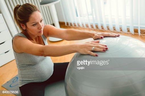 Pregnant Woman Exercising Pilates.