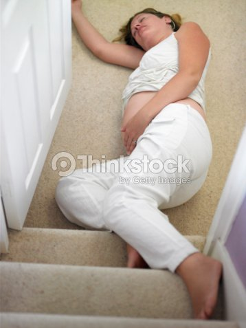 Pregnant Woman Falling Down Stairs Stock Photo