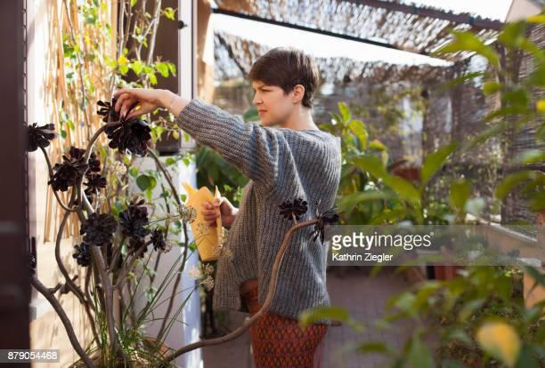Pregnant woman gardening on terrace