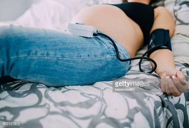 Pregnant woman having pressure measured