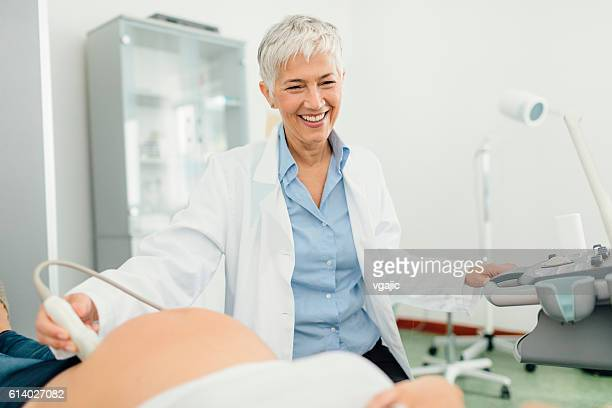 Pregnant Woman Having Ultrasound Exam In Doctors Office
