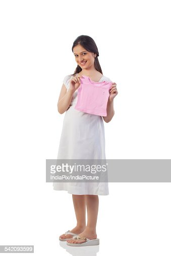Pregnant woman holding a baby t-shirt