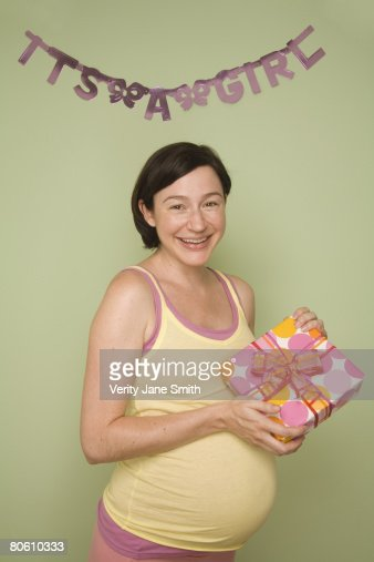 Pregnant woman holding gift : Stock Photo