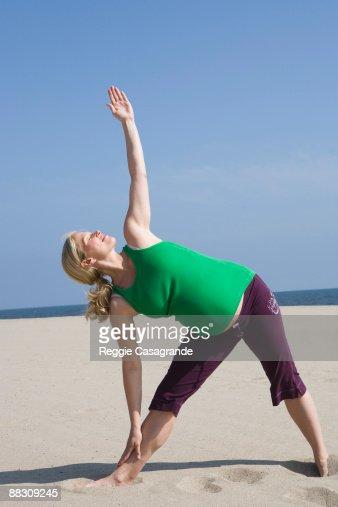 Pregnant woman in Triangle pose