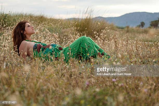 Pregnant woman lying in field