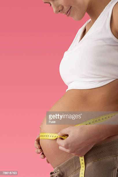 Pregnant Woman Measuring Her Stomach