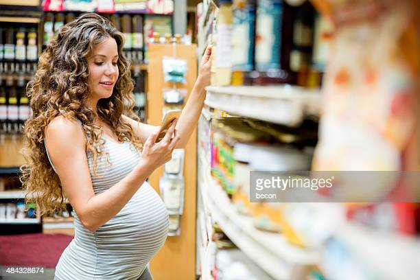 Pregnant Woman on Phone in Grocery Store