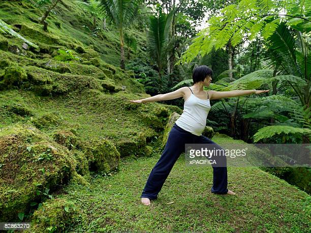 A pregnant woman practicing yoga.