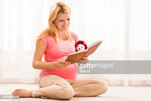 Pregnant woman reading a book. : Stock Photo
