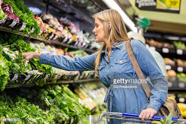 Pregnant woman shopping for healthy food in supermarket