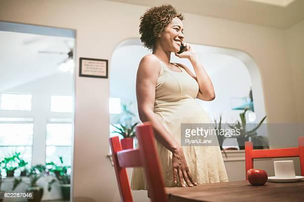 Pregnant Woman Talking on Smart Phone