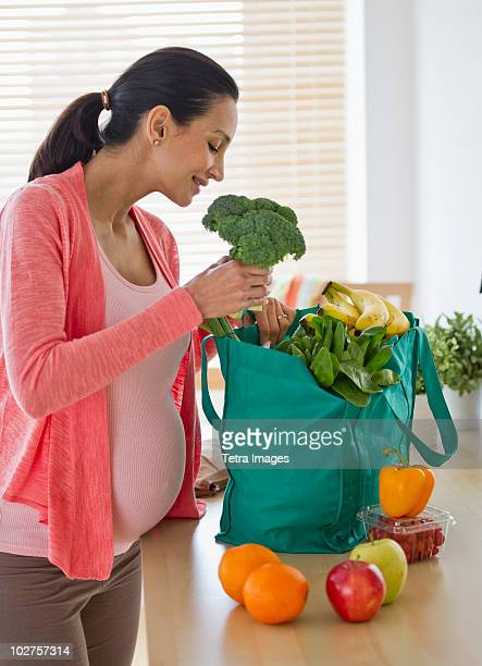 Pregnant woman unpacking groceries