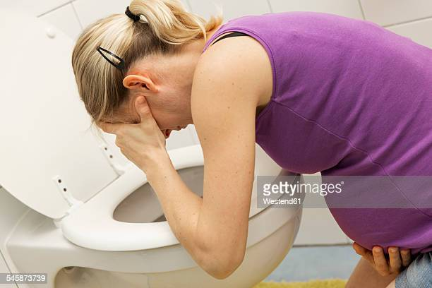 Pregnant woman vomiting