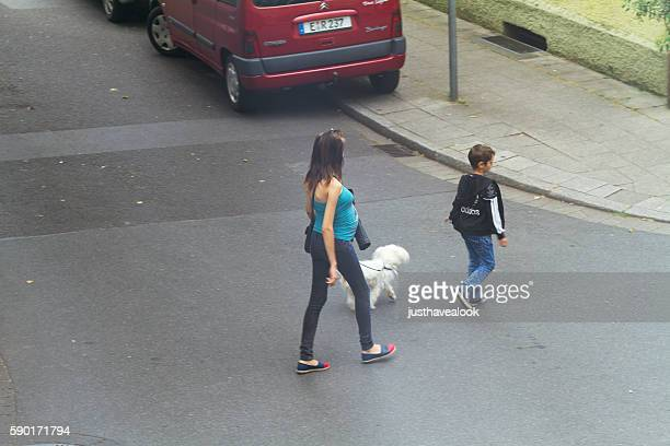 Pregnant woman with boy and dog