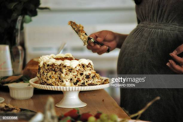 Pregnant Woman with Cake Slice