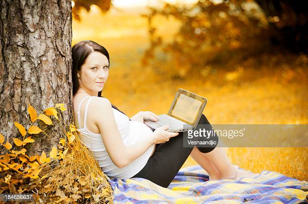 Pregnant woman with computer