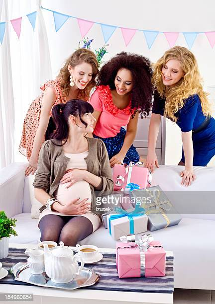 Pregnant woman with friends at baby shower