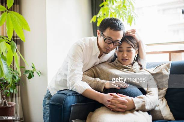 Pregnant woman with her husband in room