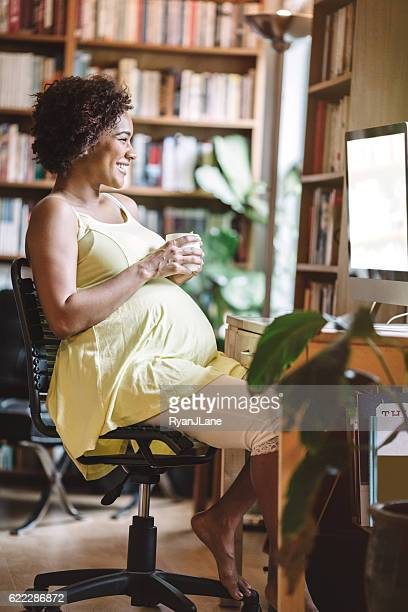 Pregnant Woman Working in Office