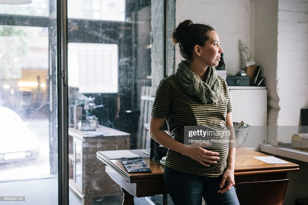 Pregnant woman working in Roastery