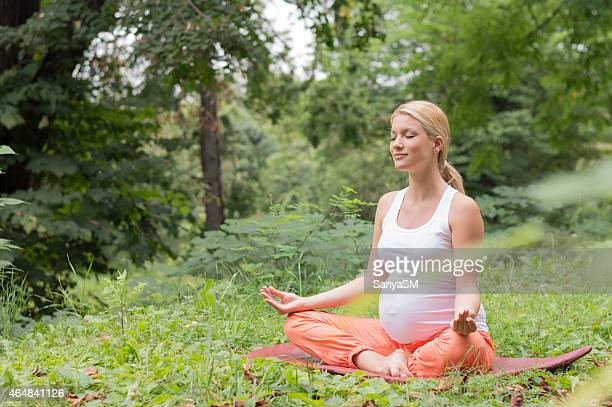 Pregnant woman's sitting in a position lotus