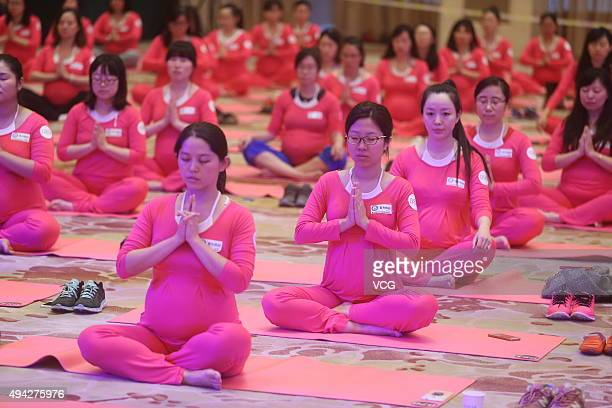 Pregnant women practice yoga at the Diaoyutai State Guesthouse on October 25 2015 in Beijing China 1443 pregnant women scattered in eight cities...