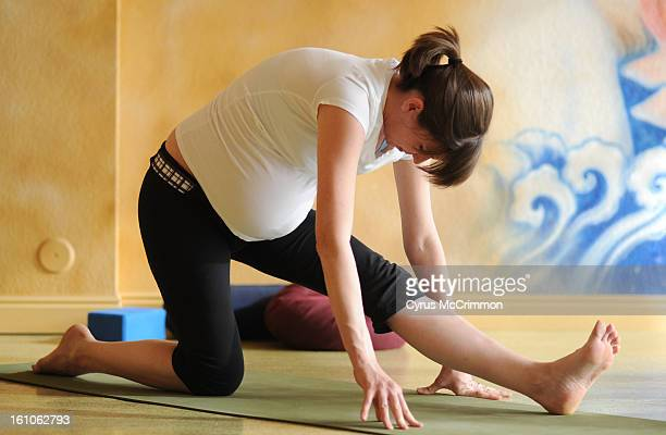FE15FTYOGA_CM05 Pregnant yoga student Meghan Berglind in Wendy Correa's prenatal yoga class at the Samadhi Center for Yoga at 639 E 19th Ave on...