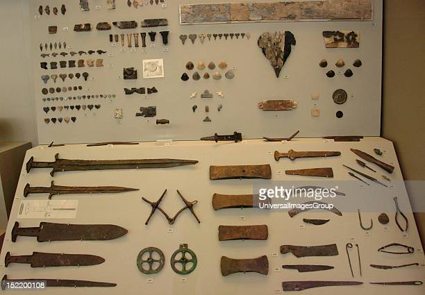 Prehistoric Art Age of Metals Greece Different types of knives axes and various utensils National Archaeological Museum Athens