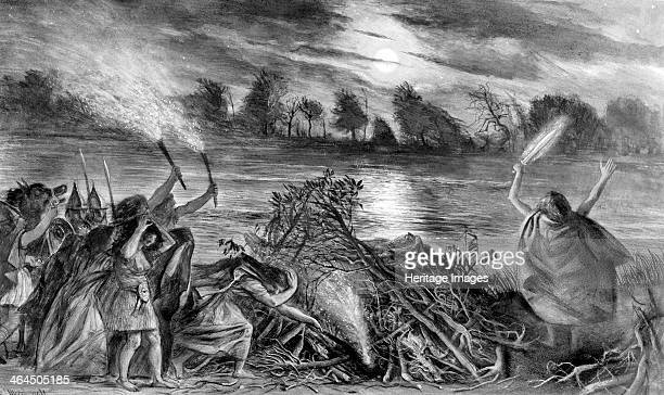 Prehistoric warrior's funeral This artist's impression shows a funeral pyre being ignited and the warrior's sword is being offered to the river This...