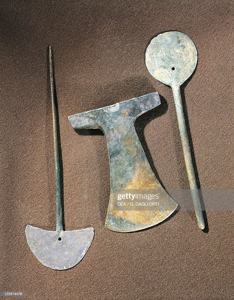 Pre-Inca civilization, Bolivia, 1st-13th century A.D. Tiwanaku culture. Iron axe and large pins.