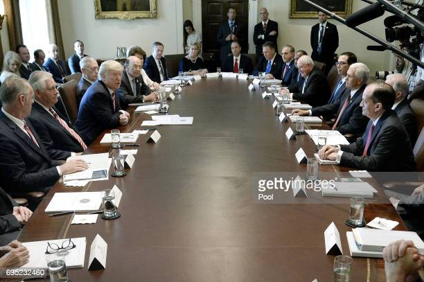 US Preisdent Donald Trump attends a meeting in the Cabinet Room of the White House June 12 2017 in Washington DC Also in attendence was US Attorney...