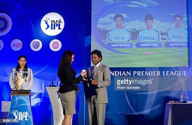 Preity Zinta Bollywood actress and coowner of the Kings XI Punjab appears on stage with Lalit Modi the chairman and commissioner of the IPL at the...