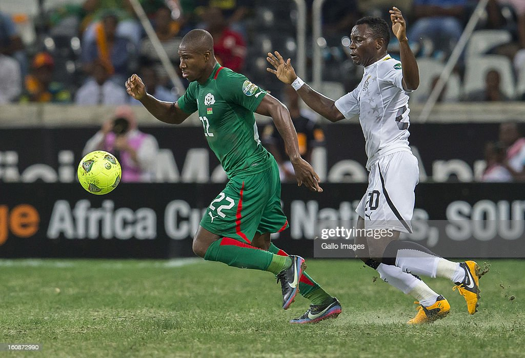 Prejuce Nakoulma from Burkina Faso (L) and Kwadwo Asamoah from Ghana (R) during the 2013 Orange African Cup of Nations 2nd Semi Final match between Burkina Faso and Ghana at Mbombela Stadium on February 06, 2013 in Nelspruit, South Africa.