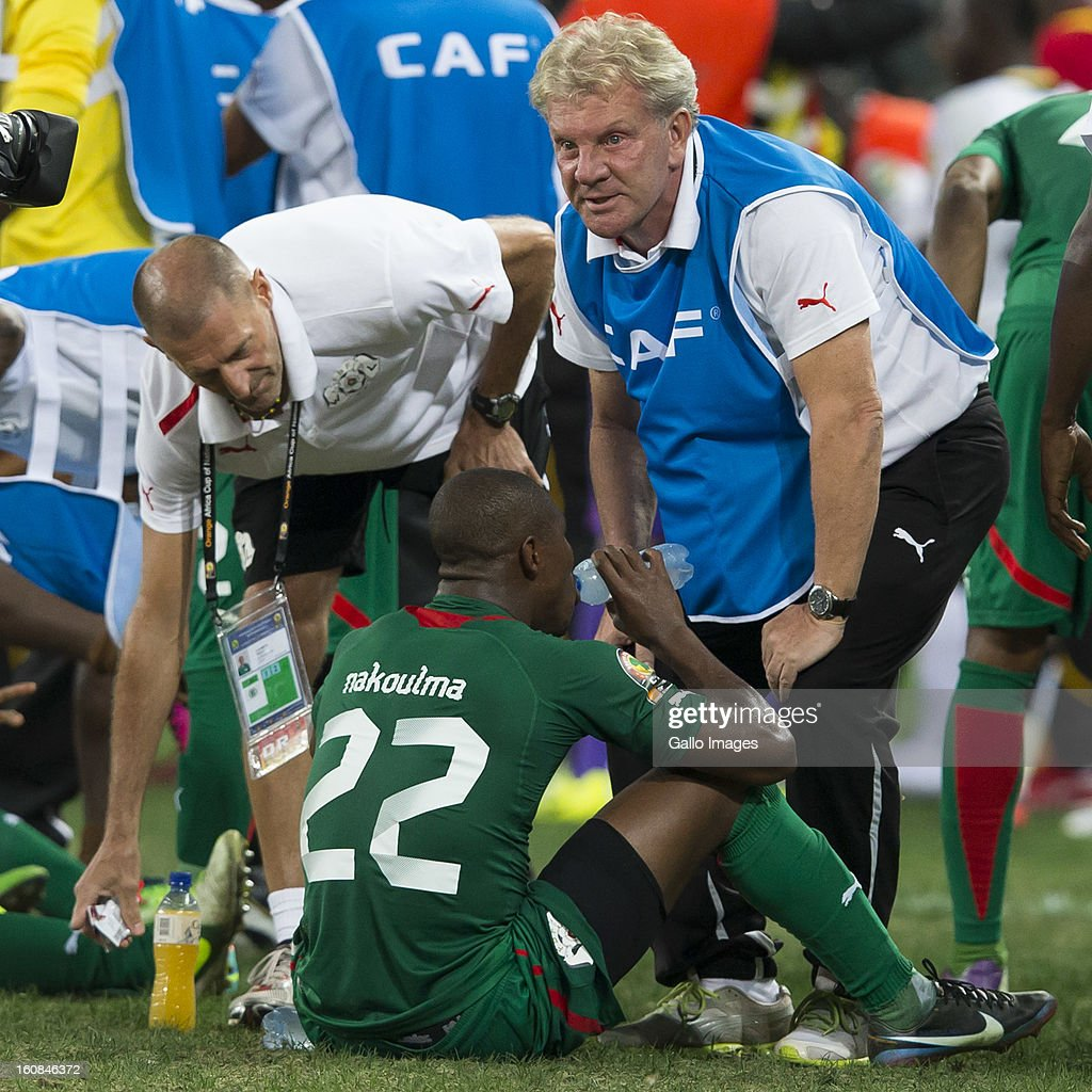 N Prejuce Nakoulma from Burkina Faso (L) and Paul Put, Burkina Faso Manager, during the 2013 Orange African Cup of Nations 2nd Semi Final match between Burkina Faso and Ghana at Mbombela Stadium on February 06, 2013 in Nelspruit, South Africa.
