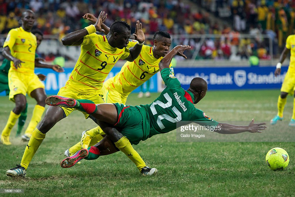 N Prejuce Nakoulma of Burkina Faso tackled by Vincent Bossou of Togo during the 2013 African Cup of Nations 4th Quarter Final match between Burkina Faso and Togo at Mbombela Stadium on February 03, 2013 in Nelspruit, South Africa.