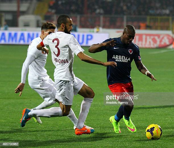 Prejuce Nakoulma of Mersin Idmanyurdu in action against Jose Bosingwa of Trabzonspor during Turkish Spor Toto League football match between Mersin...