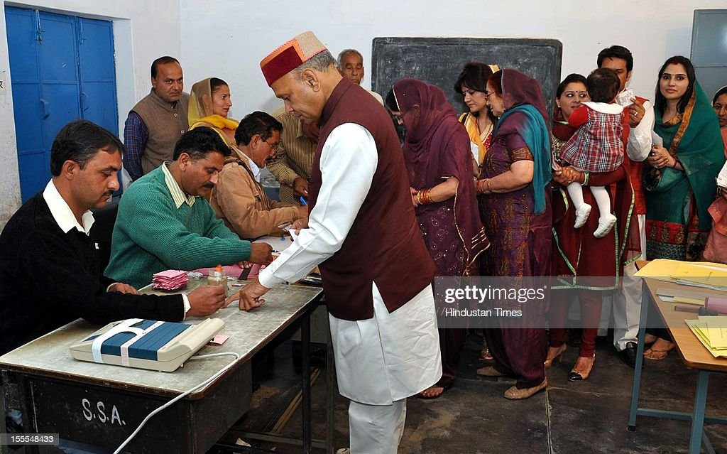 Prem Kumar Dhumal, Chief Minister of Himachal Pradesh prepares to cast his vote for the Himachal Assembly election at a polling station in his native village, Sameerpur, near Hamirpur, on November 04, 2012 in Himachal Pardesh, India. Voting figures have indicated a high percentage turnout for polling in the assembly election.
