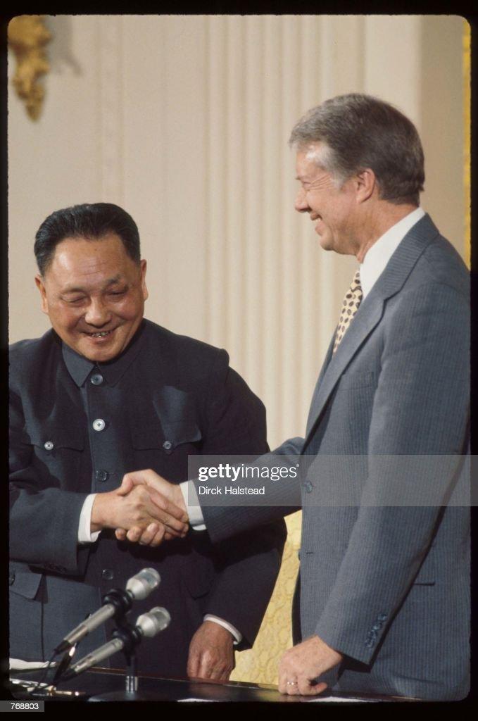 Premier Deng Xiaoping and President Jimmy Carter shake hands January 31 1979 in Washington DC Xiaoping and President Carter met in Washington DC and...