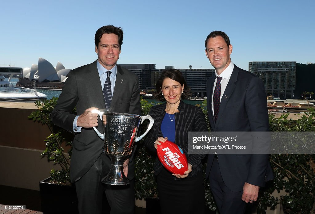 Premier Gladys Berejiklian, AFL CEO Gillon McLachlan and AFL NSW CEO Sam Graham pose with the AFL trophy during the AFL Grand Final media announcement at The Museum of Contemporary Art Australia on September 6, 2017 in Sydney, Australia.