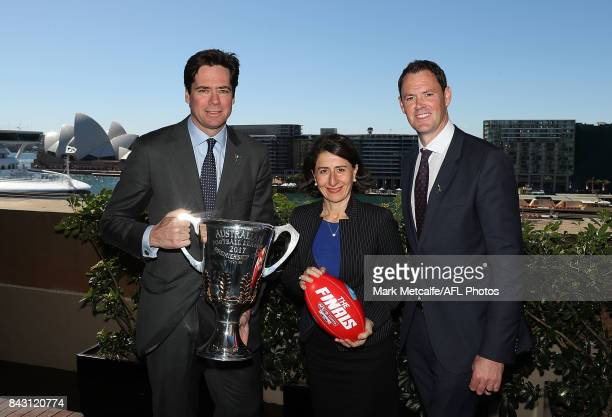 Premier Gladys Berejiklian AFL CEO Gillon McLachlan and AFL NSW CEO Sam Graham pose with the AFL trophy during the AFL Grand Final media announcement...