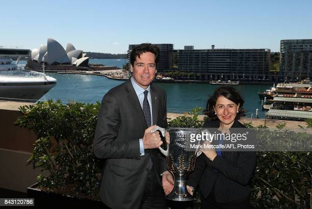 Premier Gladys Berejiklian and AFL CEO Gillon McLachlan pose with the AFL trophy during the AFL Grand Final media announcement at The Museum of...