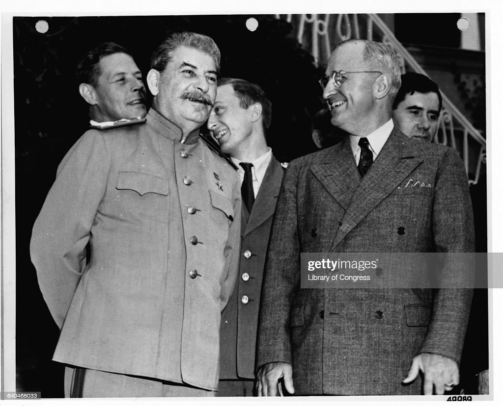 Premier <a gi-track='captionPersonalityLinkClicked' href=/galleries/search?phrase=Joseph+Stalin&family=editorial&specificpeople=91259 ng-click='$event.stopPropagation()'>Joseph Stalin</a> and President Harry S. Truman smiling during the Potsdam Conference. Presidential advisor Charles E. Bohlen stands in the background.