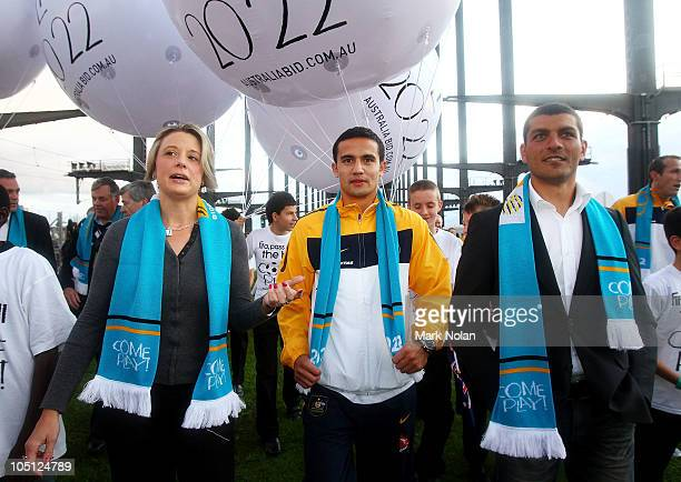 NSW Premier Kristina Keneally Tim Cahill and John Aloisi walk on the Sydney Harbour Bridge on October 10 2010 in Sydney Australia Traffic on the...