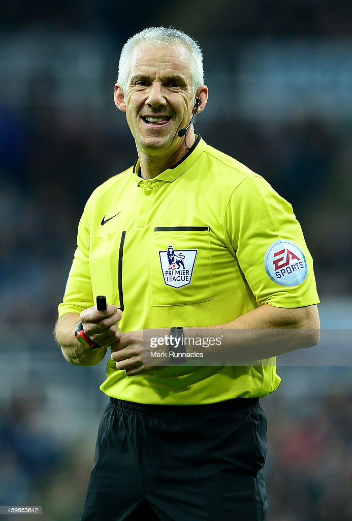 Premier League referee <a gi-track='captionPersonalityLinkClicked' href=/galleries/search?phrase=Chris+Foy+-+%C3%81rbitro&family=editorial&specificpeople=696483 ng-click='$event.stopPropagation()'>Chris Foy</a> smiles during the Barclays Premier League match between Newcastle United and Queens Park Rangers at St James Park on November 14, 2014 in Newcastle Upon Tyne, England.