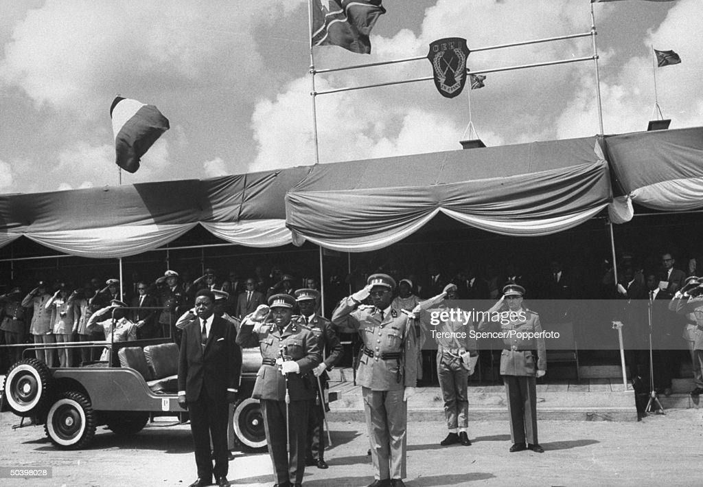 Premier Moise Tshombe (fore L), Pres. Joseph Kasavubu (fore C) and Gen. Joseph D. Mobutu (fore R) attending opening ceremonies of new military training camp.