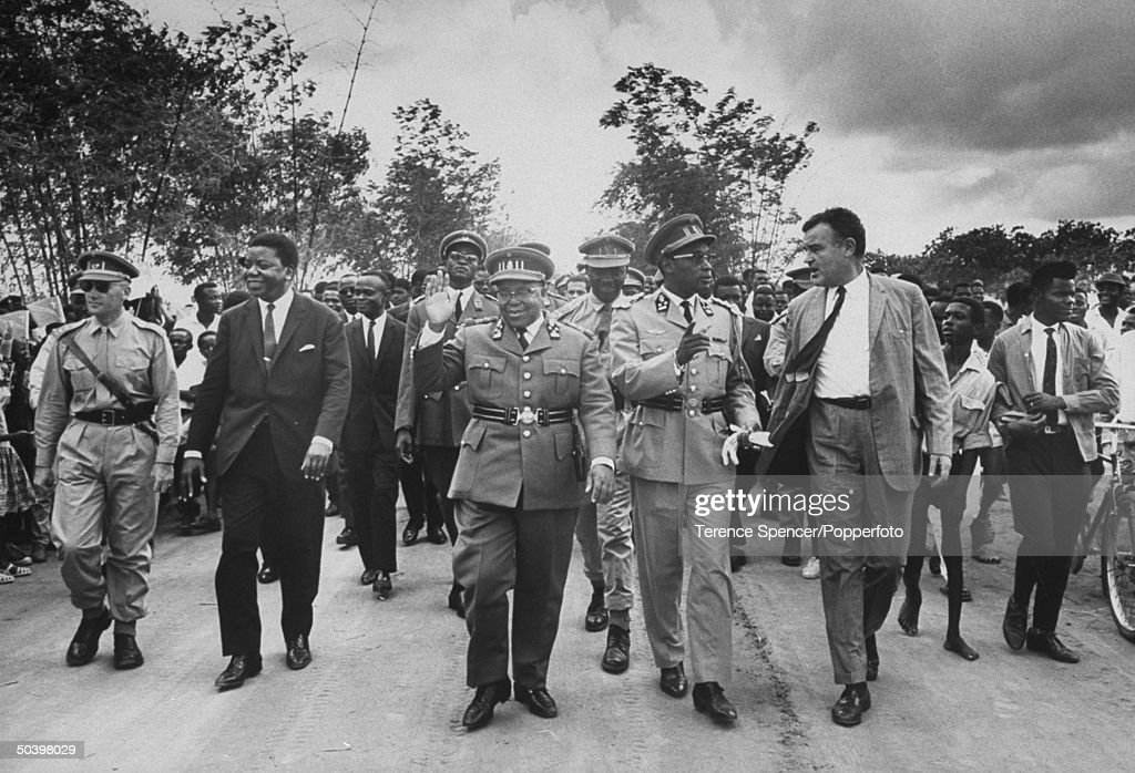 Premier Moise Tshombe (fore 2L), Pres. Joseph Kasavubu (fore C), Gen. Joseph D. Mobutu (fore 2R) and US Ambassador McMurtrie Godley (fore R) attending opening ceremonies of new military training camp.