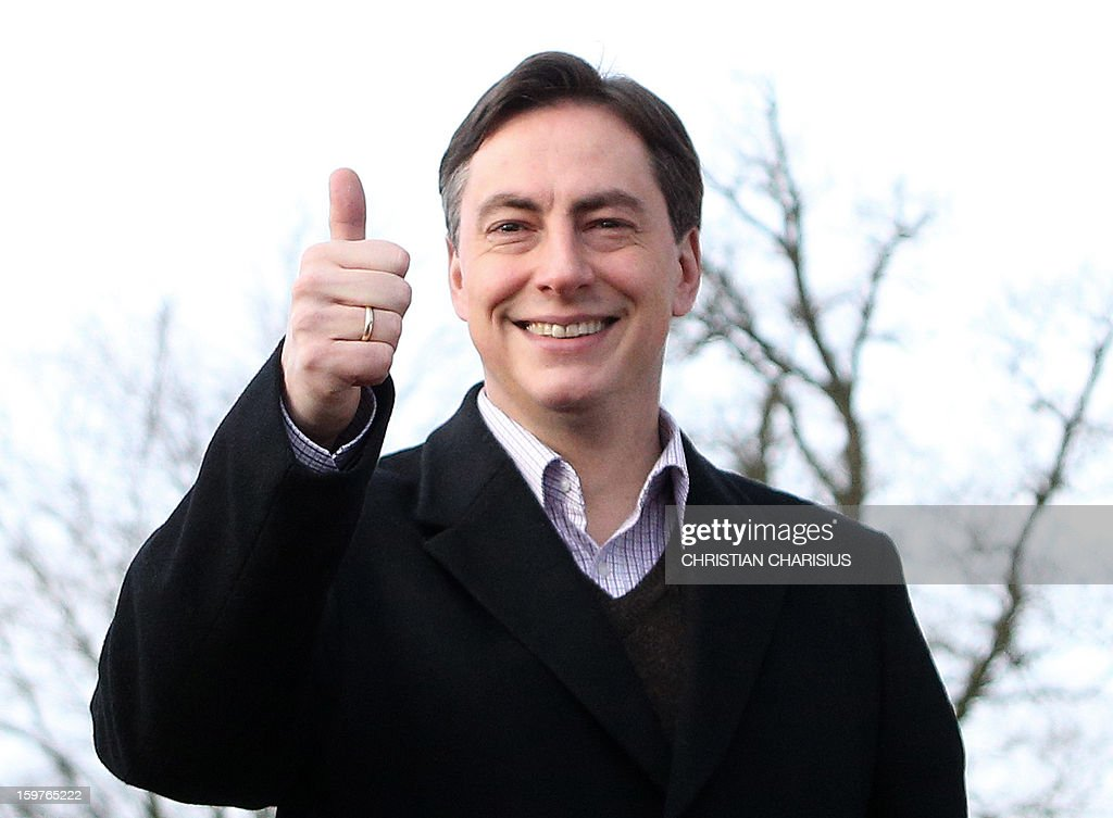 Premier of Lower Saxony and CDU top candidate David McAllister gestures after his vote at a polling station in Bad Bederkesa, Germany, on January 20, 2013. The vote is largely seen as a test run for autumn's federal election in September. AFP PHOTO / CHRISTIAN CHARISIUS GERMANY OUT