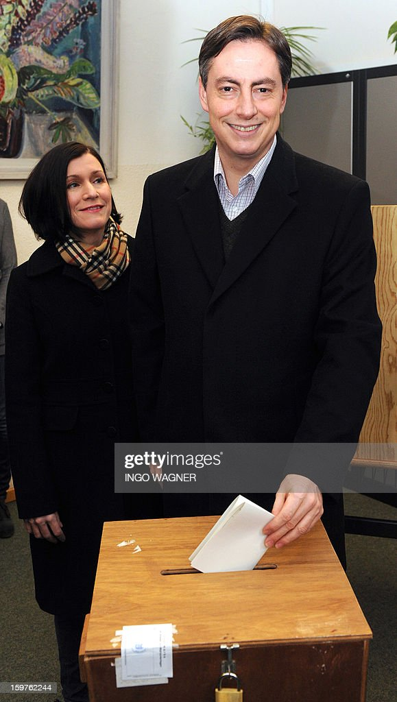 Premier of Lower Saxony and CDU top candidate David McAllister and his wife Dunja McAllister cast their ballots for the Lower Saxony state elections, at a polling station in Bad Bederkesa, Germany, on January 20, 2013. The vote is largely seen as a test run for autumn's federal election in September.