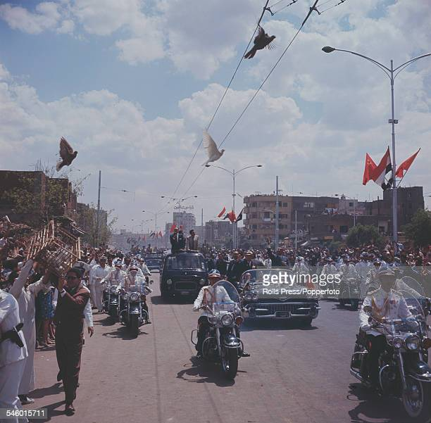 Premier of the Soviet Union Nikita Khrushchev rides with Egyptian President Gamel Abdel Nasser in a motorcade through the streets of Cairo during a...